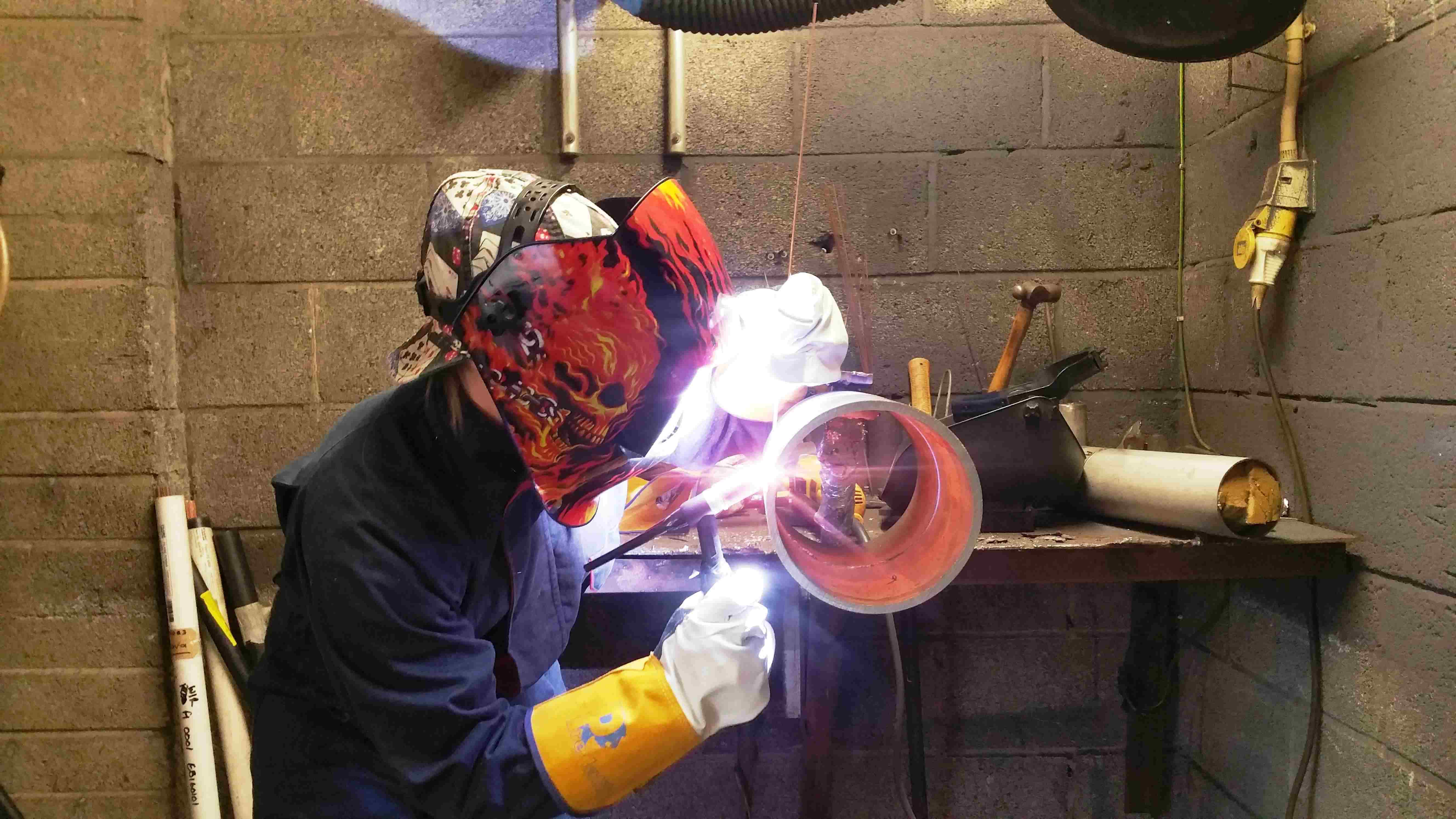 A welder practicing in our bespoke training facility before completing their coding test piece
